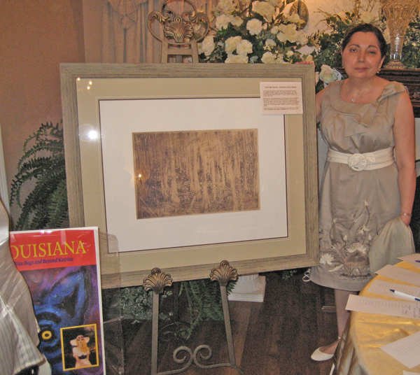 Artist Susan Talbot Hoffmann Posing in front of her donated aretwork (Cypress Swamp II)...donated for HOPE FOR ANIMALS